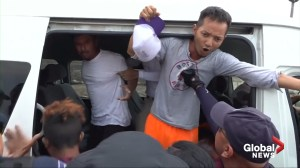 Mexican police round up caravan migrants